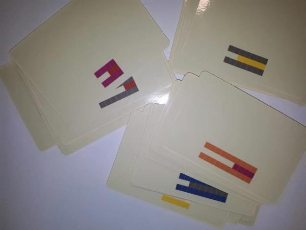cards laid out Cuisenaire rods